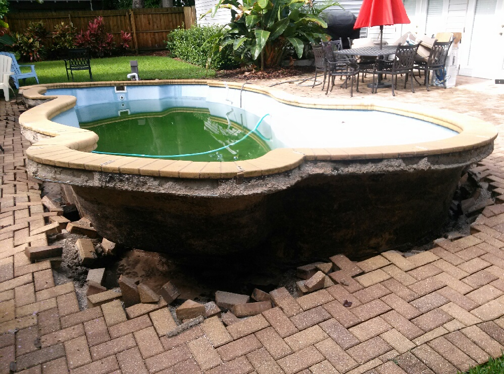 Pool popping out of ground chris hounchell associates for Pop up swimming pool maintenance